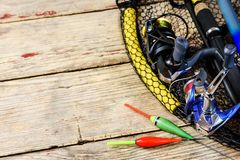 Fishing rods on wooden table royalty free stock photography