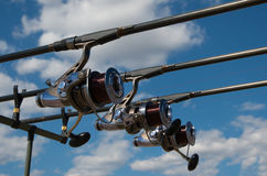 Fishing rods with reels on a support system rod pod and tourist tent the holiday camp on the bank. royalty free stock photography