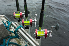 Fishing rods and reels with yellow fishing line Royalty Free Stock Image
