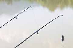 Fishing rods on riverside Stock Photos