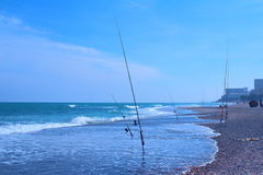 Fishing rods in the sea Royalty Free Stock Image