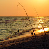 Fishing rods set up on beach Royalty Free Stock Photos