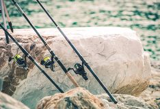Fishing Rods on the Shore Stock Photo