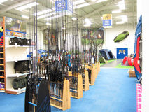 Fishing rods in a store. Stock Image