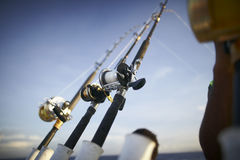 Fishing rods from towing boat. With fishing lines stretched in the sea Royalty Free Stock Image