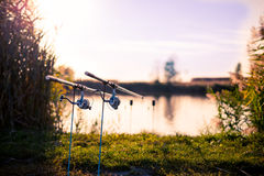 Fishing rods. Two fishing poles in rod holders on side of the lake Royalty Free Stock Photography