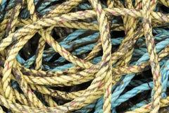 Fishing ropes piled up. Fishing ropes in blue and yellow,piled up, North coast, Scotland, UK royalty free stock image