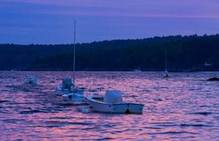 Fishing and Sail Boats tied up for the night. These fishing and sail boats are tied up at sunset, near Boothbay Harbor, Maine royalty free stock image