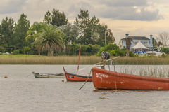 Fishing and Sailboats at Santa Lucia River in Montevideo Stock Photo