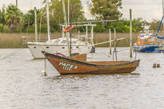 Fishing and Sailboats at Santa Lucia River in Montevideo Stock Image