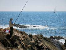 Fishing and sailing Stock Images