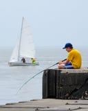 Fishing and sailing Royalty Free Stock Image
