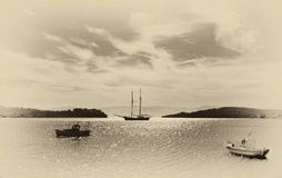 Fishing and sailing boats in the bay. Fine art image canvas text stock images