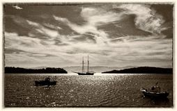 Fishing and sailing boats in the bay. Fine art image canvas texture and frame added.Sepia tone stock images