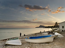 Fishing Scene. With some boats in the foreground, taken at sunset in Altea, a beautiful town located in the Costa Blanca of Spain Stock Photos