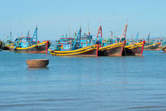 Fishing schooners in the Fish harbor of the village of Mui Ne early in the morning. Vietnam Stock Photo