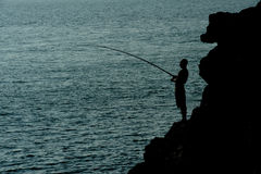 Fishing in the sea Royalty Free Stock Photos