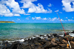 Fishing By the Sea, Kauai Hawaii Stock Photo