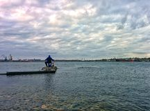 Fishing in sea port Royalty Free Stock Photography