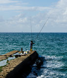 Fishing in the sea Royalty Free Stock Images