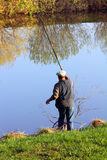 Fishing senior on lake Stock Image