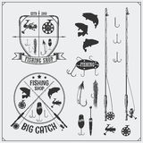 Fishing set. Fishing labels and emblems. Fishing equipment, hooks and lures. Black and white illustration Stock Photography