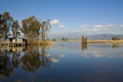 Fishing shack on lake royalty free stock images
