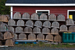 Fishing shack and lobster pots. Stack of lobster pots or traps with wooden fishing stack in background, Newfoundland, Canada Royalty Free Stock Image
