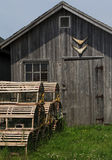 Fishing Shack. Lobster pots stacked in front of a fishing shack Royalty Free Stock Image