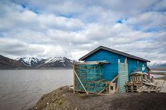 Fishing shack next to bay in Longyearbyen, Svaldbard, Spitzbergen. Fishing shack with traps next to bay in Longyearbyen, Svaldbard, Spitzbergen Stock Photo