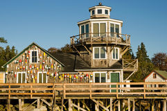 Fishing shack and pier. A unique fishing shack on a pier with lobster buoys Stock Photo