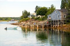Fishing shack and pier. An early morning view of a privately owned fishing shack and dock on beautiful and quaint Bass Harbor, Maine Royalty Free Stock Photo
