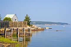Fishing shack and pier royalty free stock photo