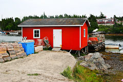 Fishing shack by river stock photo