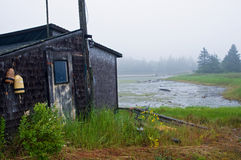Fishing shack on tidewater inlet Stock Image