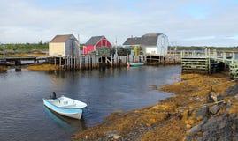 Fishing village,Nova Scotia. A picturesque landscape of colorful fishing shacks ,lobster traps and boats along the coast of Nova Scotia near Lunenburg Stock Image