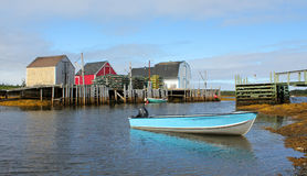 Fishing village, Nova Scotia. A picturesque landscape of colorful fishing shacks ,lobster traps and boats in a peaceful cove Blue Rocks, Nova Scotia Stock Photography