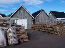 Fishing shacks with Lobster Traps royalty free stock photography