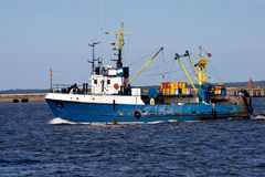 Fishing ship. In port going to the sea Stock Image