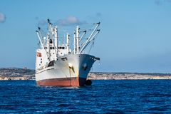 Fishing ship copy space. Industrial fishing ship in Malta Stock Photo