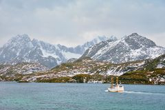 Fishing ship in fjord in Norway Royalty Free Stock Photo
