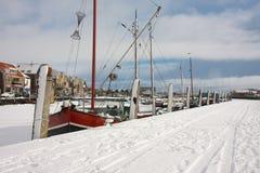 Fishing ship in frozen harbor Royalty Free Stock Image