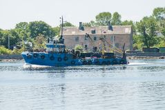Fishing ship goes via Baltic sea channel to base Royalty Free Stock Photos