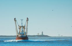 Fishing ship in harbor royalty free stock photography