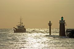 Fishing ship leaving port. In France Stock Photography