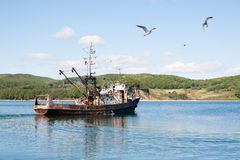 Fishing ship out to sea Royalty Free Stock Photo