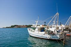 Fishing ship in the port of Porec stock photo