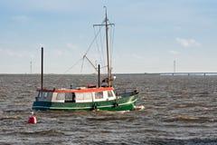 Fishing ship sailing to the sea. Dutch fishing ship sailing to the sea stock photos