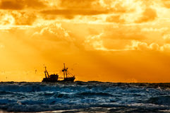 Fishing ship at sea. With sunset Royalty Free Stock Photos