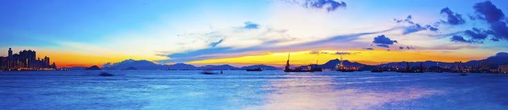 Fishing ship at sea with sunset along Hong Kong coastline Royalty Free Stock Image